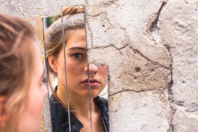 girl-looking-her-reflection-mirror-fragments-wall-street-teen-51988733