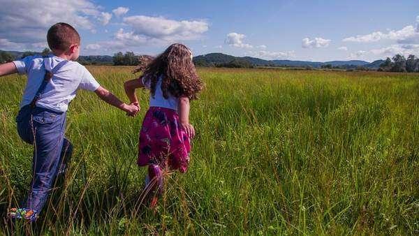 Kids running through the fields