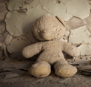 old destroyed teddy bear