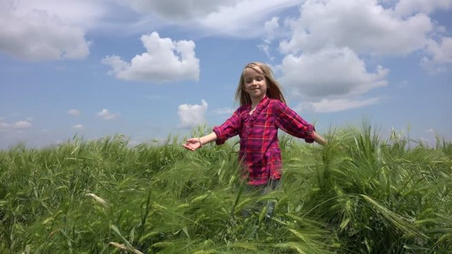 child playing in the field